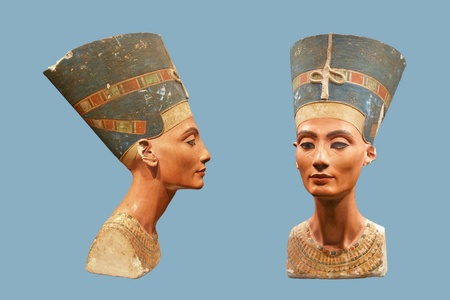 bust: BERLIN - SEPTEMBER 2005: Famous bust of Queen Nefertiti in Berlin Pergamon Museum isolated obn blue, September 4, 2005 in Berlin, Germany