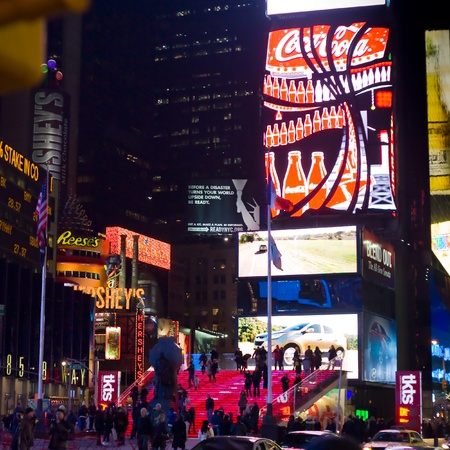 advertise with us: NEW YORK CITY - FEBRUARY 4: Times Square and Broadway Theaters with crowd of tourists and residents at night, one from symbols of New York City, February 4, 2010 in Manhattan, New York City.