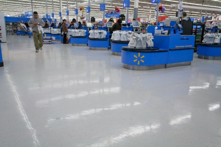 supermarket checkout: interior of WalMart department store, February 2, 2010, USA