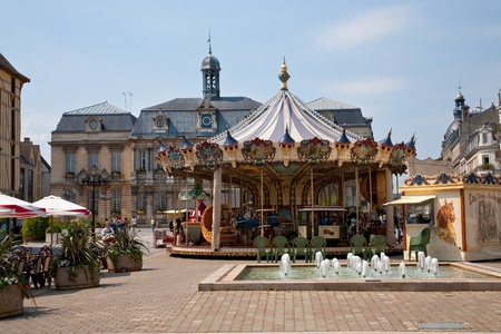 Traditional merry-go-round on square in Troyes, France on June 29, 2010