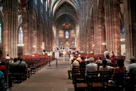 pew: church service in Cathedrale Notre-Dame, Strasbourg, France on July 11, 2010