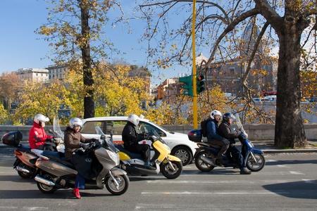 Scooters - popular urban transport on Italian street on December 16, 2010 in Rome, Italy