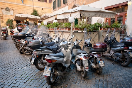 lunch time - scooters around restaurant in Rome on December 16, 2010