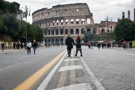 tourists walk to Colosseum in Rome on December 19, 2010