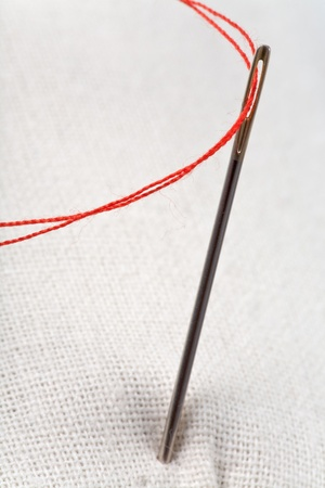 needle with red thread Stock Photo