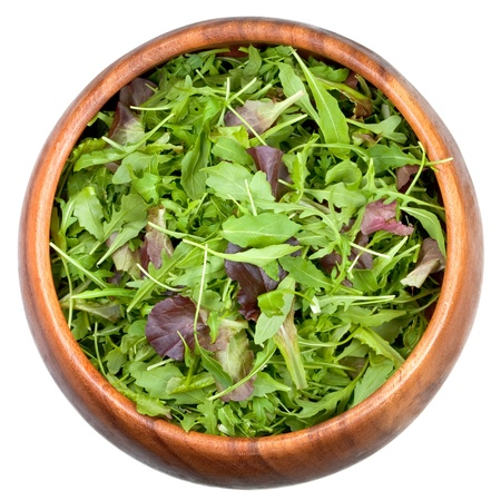 fresh salad mix in wooden bowl photo