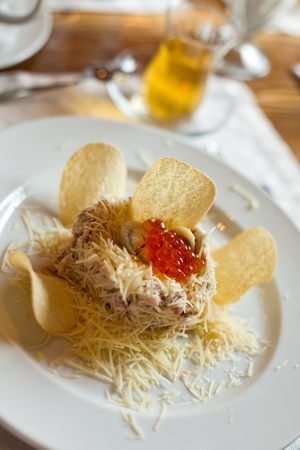 appetizer with quail egg, meat, ham, grated cheese, red caviar photo