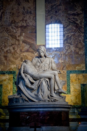catholical: ROME, ITALY - DECEMBER 16: The Pieta is a masterpiece of Renaissance sculpture by Michelangelo Buonarroti, housed in St. Peters Basilica in Vatican City in Rome, on December 16, in Rome, Italy