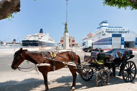 palermo   italy: PALERMO, ITALY - JUNE, 24: horse-drawn taxi in seaport in Palermo, Italy on June 24, 2011