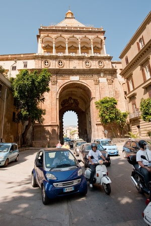 palermo   italy: PALERMO, ITALY - JUNE, 24: traffic near Porta Nuova - historical medieval triumphal gateway in Palermo, Sicily on Lune 24, 2011
