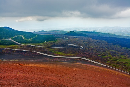 volcano slope: serpentine road on slope of volcano Etna, Sicily, Italy Stock Photo
