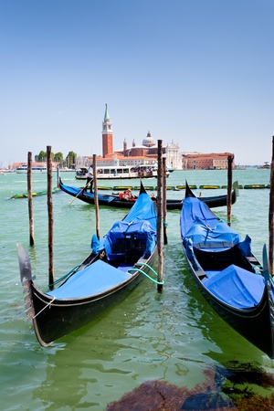 VENICE, ITALY - JUNE,23: gondolas and view on San Giorgio Maggiore through San Marco Canal in Venice, Italy on June 23, 2011