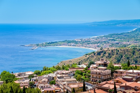 view on town Taormina and resort Gardini Naxos on Ionian coast, Sicily photo