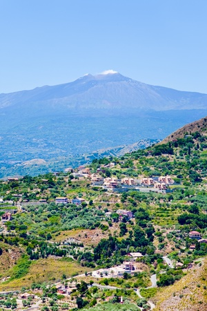 view on Etna and agricultural gardens on flank of hills in Sicily photo
