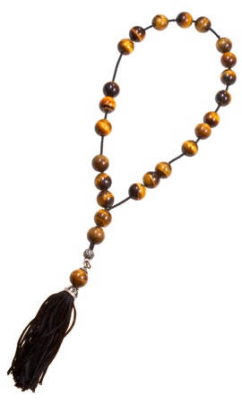 a beads: tigers-eye stone prayer bead isolated on white