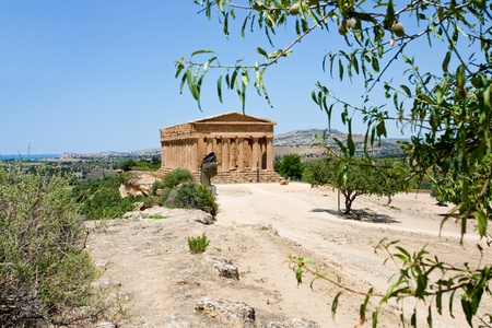 view on Temple on Concordia in Valley of Temples and  town Agrigento, Sicily  photo