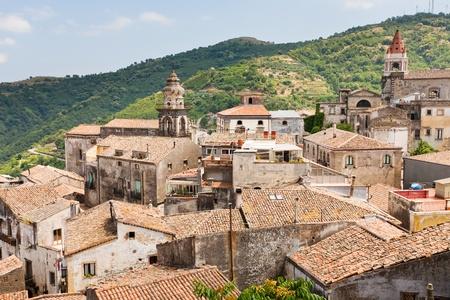 view on ancient tile roofs and tower of Sant Antonio church in Castiglione di Sicilia Imagens