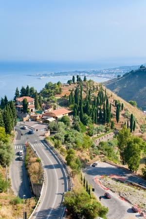 view on town Taormina and resort Giardini Naxos on Ionian coast, Sicily