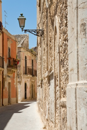 narrow late baroque style Rome street in Syracuse, Italy Stock Photo - 10829744