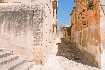 narrow street in baroque style town - Noto, Sicily photo