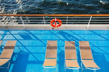 sunbath chairs on side of cruise liner photo