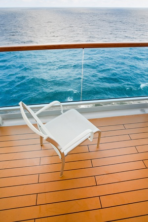 textile chair on balcony of sea cruise liner photo