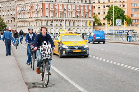 favourable: STOCKHOLM - SEPTEMBER,8: bicyclists on street in Stockholm, Sweden on September 8, 2011.  Bicycle is popular ecological transport, so about 150 thousand persons regularly go by bicycles in Stockholm.