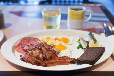 white plate with hotel full English breakfast photo
