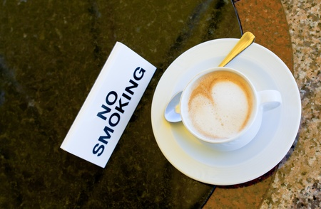 cup of cappuccino  on no-smoking table in outdoor cafe Stock Photo - 11855685