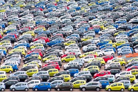 many small cars on outdoor parking in Copenhagen harbor  Editorial