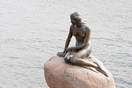 COPENHAGEN - SEPTEMBER, 10: statue of the Little Mermaid . The statue is only 1.25 metres high and weighs around 175 kg,  in Copenhagen, Denmark on September 10, 2011  Editorial