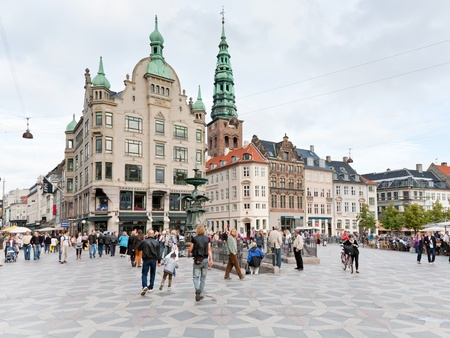 referred: COPENHAGEN - SEPTEMBER, 10: Amagertorv - central square. In 1449 it is referred to as the Fishmongers Market and in 1472 name Amagertorv first appears in Copenhagen, Denmark. On September 10, 2011