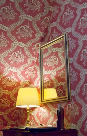 yellow retro lamp and red vintage silk wallpaper photo