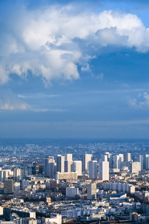 big city under high blue sky with white clouds photo