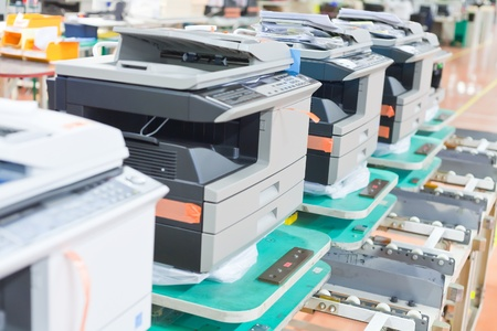 spare: several assembled copiers on factory close up