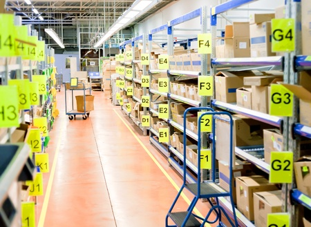 stockroom: stands with carton boxes in storage warehouse