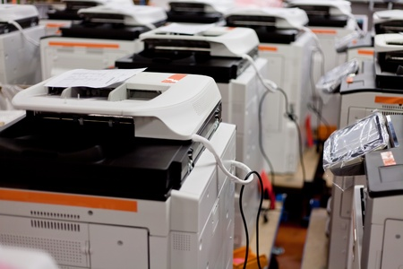 many assembled copiers on factory close up