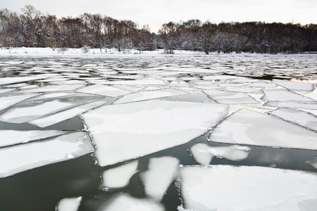 floating of ice on river at early spring evening photo