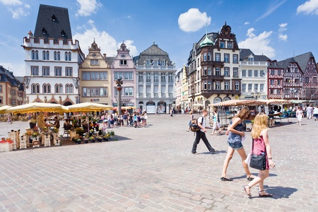 TRIER, GERMANY-  JUNE 28: old Market square. This cental square came into existence around the 10th century and marked by a replica of the original stone cross that dates back to 958, in Trier, Germany, on June 28, 2010 Stock Photo - 12159867