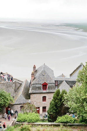 MONT SAINT-MICHEL, FRANCE - JULY 5: tidal sea bottom around Mont Saint-Michel. More than 3000000 people visit Saint Michael Stock Photo - 12159868