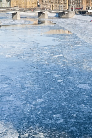ice blocks on frozen Moscow river in sunny winter day photo