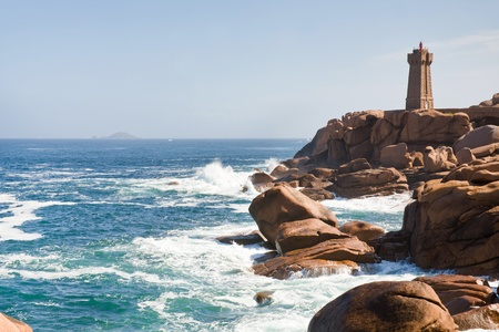 lighthouse in the rocks on Brittany Pink Granite Coast in France photo
