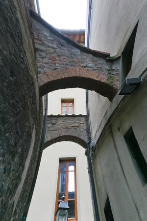 narrow medieval street in Florence, Italy photo