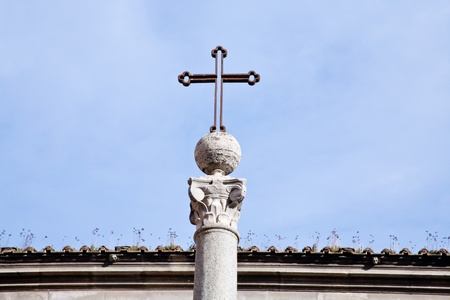 catholical: metal medieval cross on blue sky in Rome, Italy