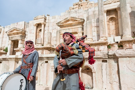 bagpipes: bedouins play on bagpipes in ancient Gerasa, Jerash, Jordan on February 18, 2012