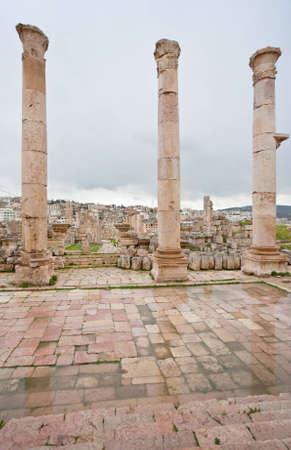 greco: view through antique Artemis temple in ancient city  Gerasa to modern Jerash , Jordan