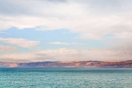 pink sunrise on Dead Sea coast photo
