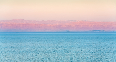 early pink sunrise  and view of Jerusalem in sunbeam on Dead Sea coast Stock Photo