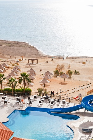 resort sand beach on Dead Sea coast in Jordan on February 19, 2012