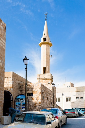 minaret in jordanian town Kerak, Jordan on February 20, 2012 Stock Photo - 12778372